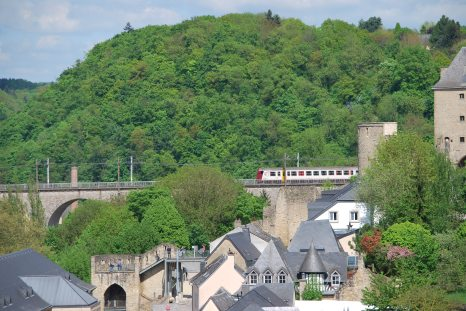 Train going over the medieval section of the city